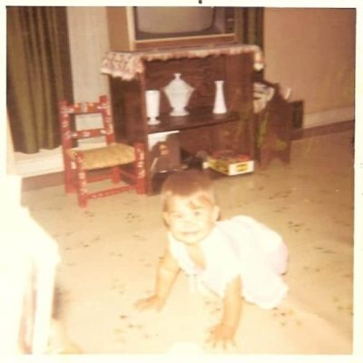Me, crawling around with milk glass on display in the background.
