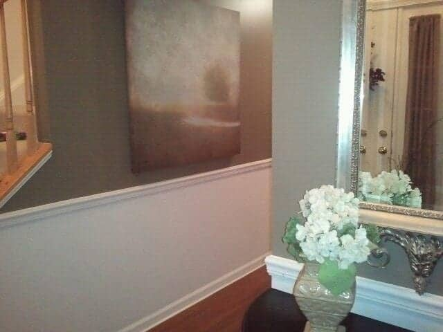 DIY Wainscoting Tutorial - adding the chair rail and priming the walls