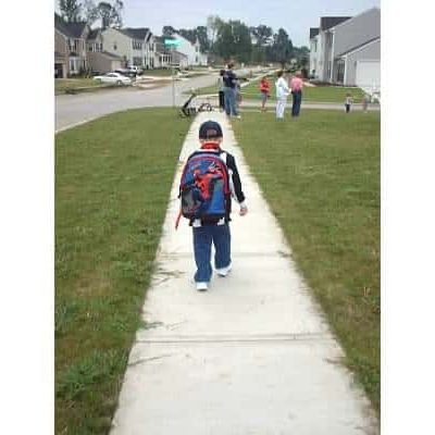 Ethan walking to bus stop 1st day of kindergarten