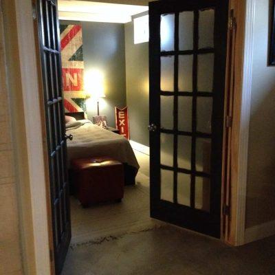 industrial basement guest room after