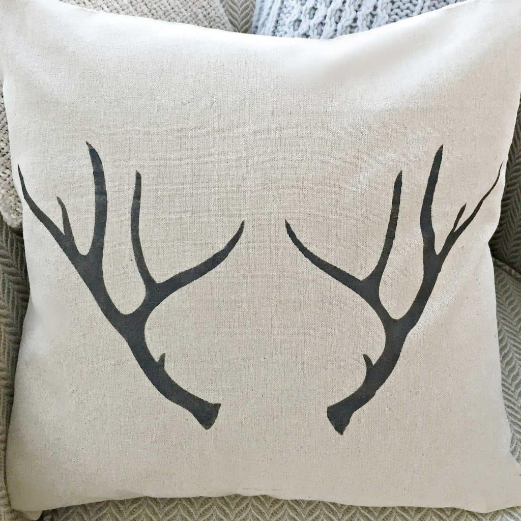 antlers pillow cover with hand drawn design by snazzy little things