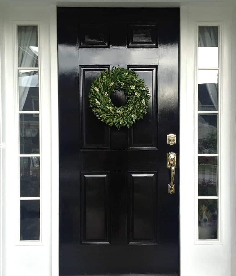 DIY: Glossy Black Front Door by SnazzyLittleThings.com