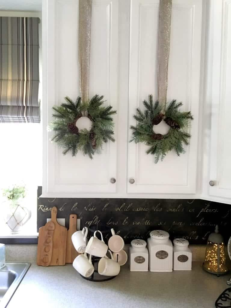Redoing Kitchen Cabinets Wreaths on Doors by SnazzyLittleThings.com