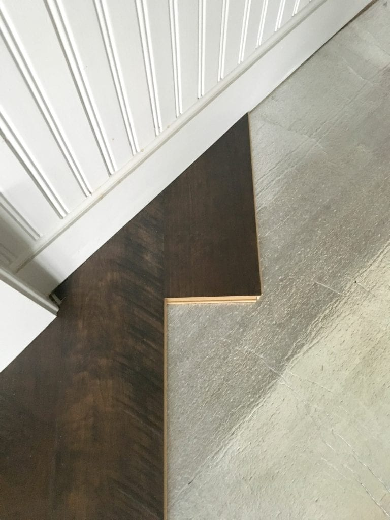 pergo-flooring-kitchen-reveal-small-cuts-near-angled-island