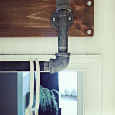 Tiny Laundry Room Update DIY Industrial Above Door Valet by SnazzyLittleThings
