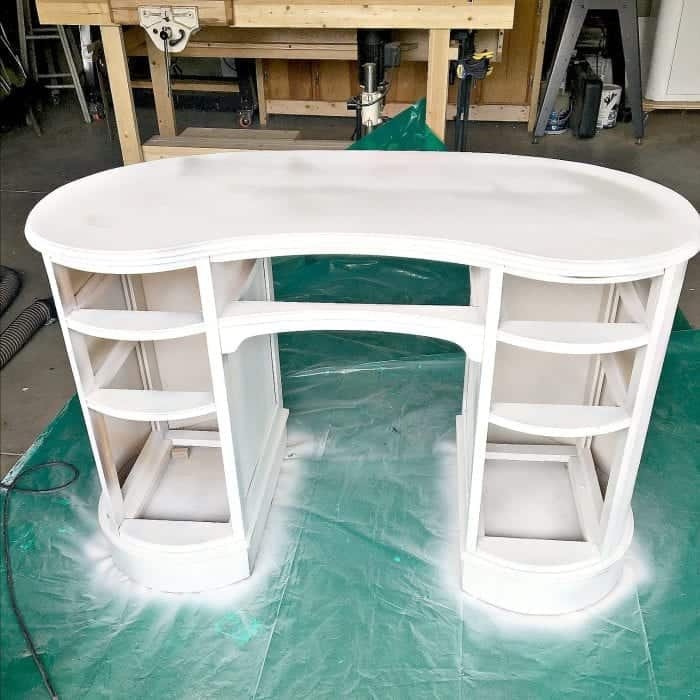 Kidney Shaped Desk Makeover Sprayed with Primer