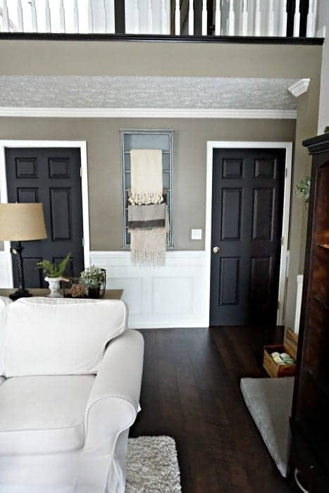 Modern Farmhouse Living Room View of Hallway Black Doors