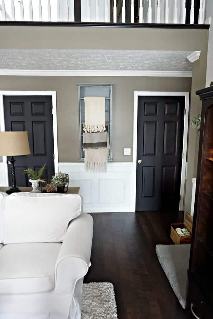Modern Farmhouse Living Room View of Hallway Black Doors