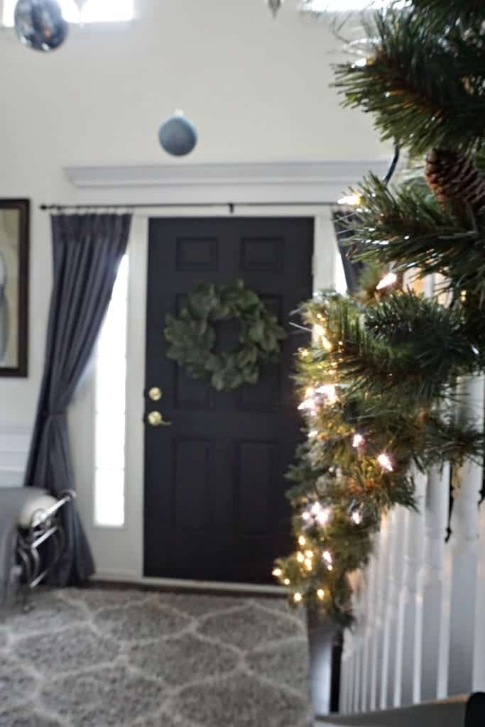 Modern Rustic Holiday Home Tour 2017 Close up of banister with lights