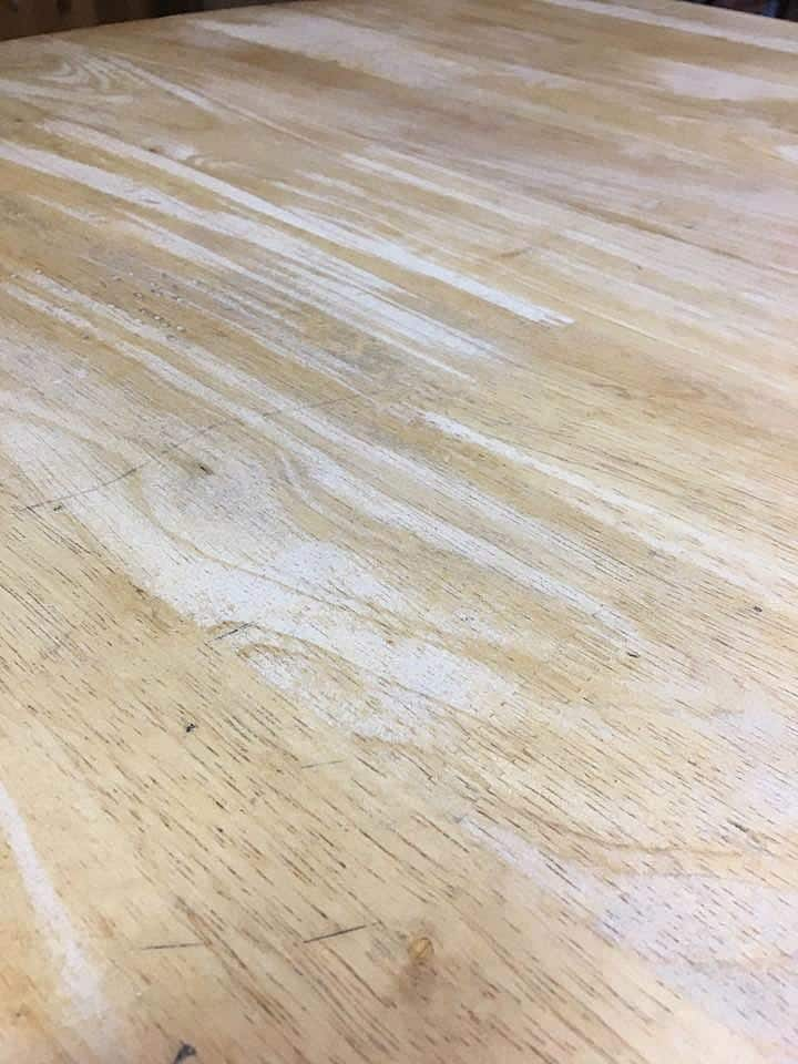 Using water to open wood pores and raise grain