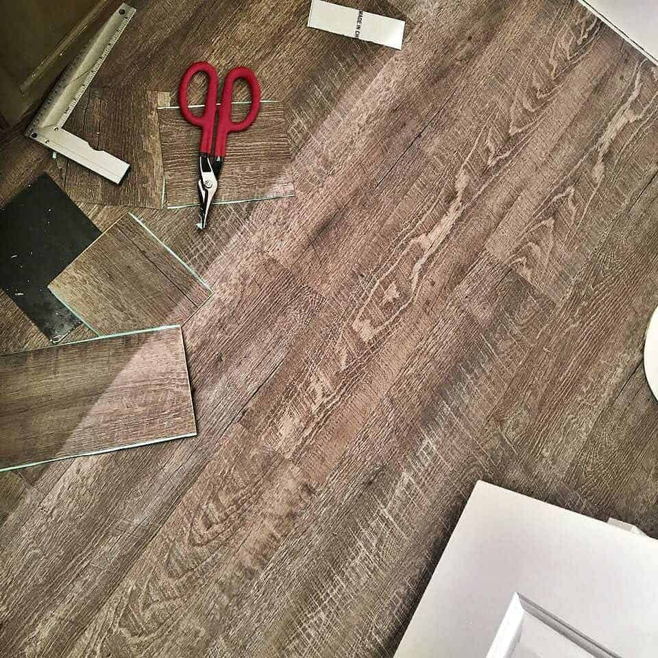 Wood Look Vinyl Plank Flooring cut with scissors
