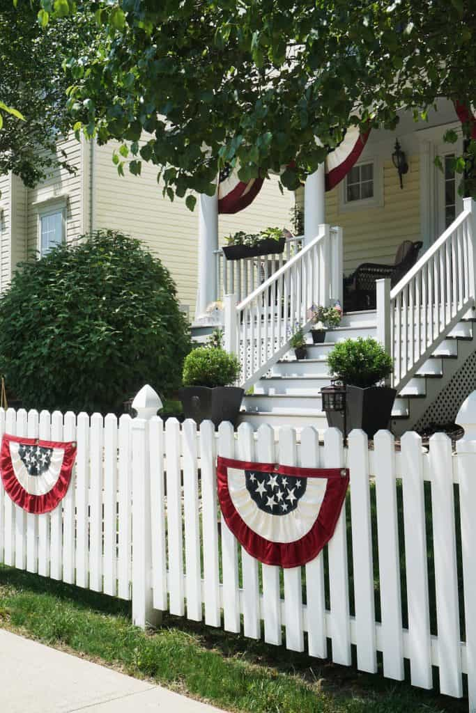 Patriotic Front Porch 2019 with White Picket Fence by SnazzyLittleThings.com