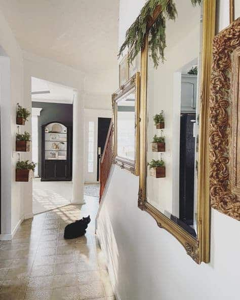 Long Hallway with Gold Vintage Mirros by Snazzy Little Things