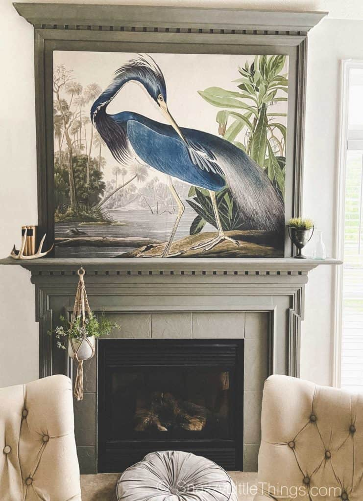 large scale wall art with wood frame over mantel
