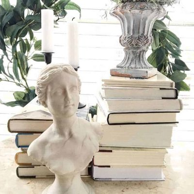 Thrifted Vintage Statue with Old Books, Old Candlesticks, Wreath
